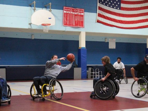 Docrchester B&GC staff participating in wheelchair basketball