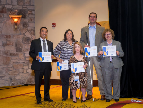 Five inductees to the Disability Mentoring Hall of Fame standing together with their certificates