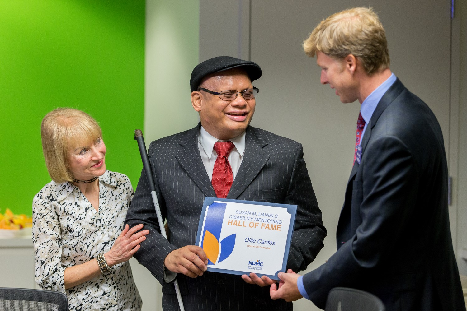 Ollie Cantos accepts his induction into the Disability Mentoring Hall of Fame