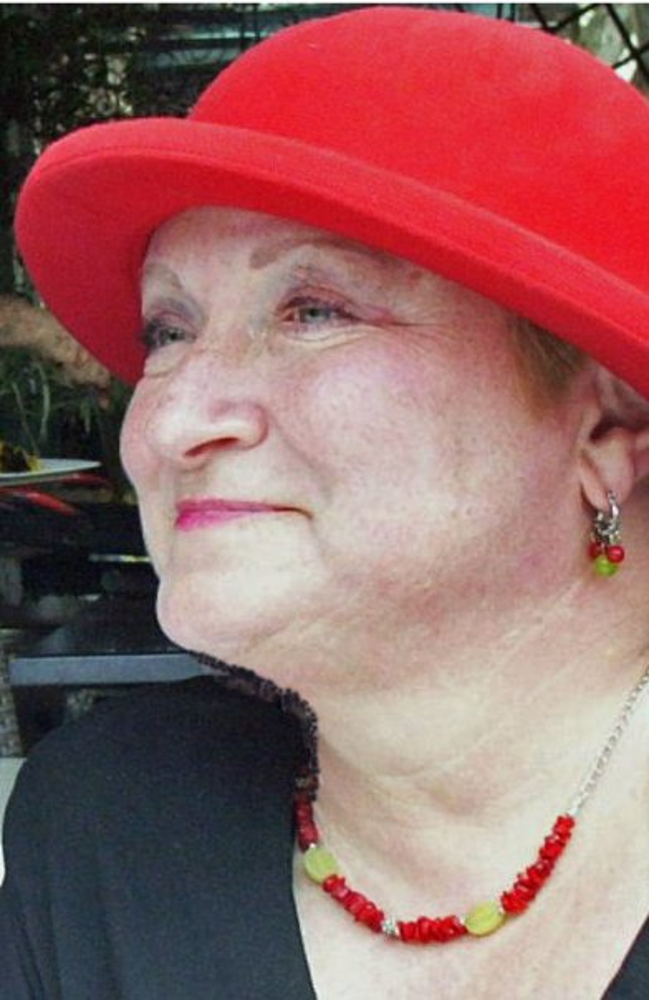Susan M. Daniels wearing a red hat